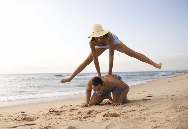 Couple playing leapfrog